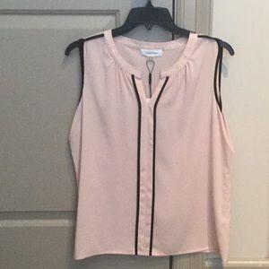 Calvin Klein pink and black sleeveless blouse.